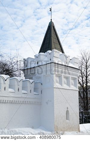 Wall With Battlements And White Stone Watchtower Of Danilov Monastery In Moscow