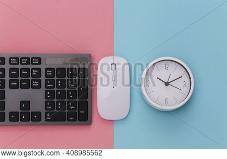 Pc Keyboard With Pc Mouse, Clock On Pink Blue Background. Top View