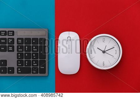 Pc Keyboard With Pc Mouse, Clock On Red Blue Background. Top View