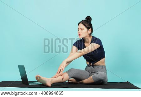 Fitness Influencer. Sporty Woman Workout Training Online Via Laptop. Copy Space.