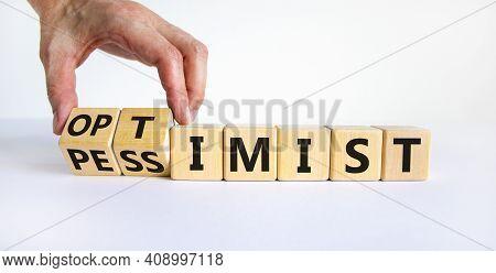 Pessimist Or Optimist Symbol. Businessman Turns Cubes And Changes The Word 'pessimist' To 'optimist'