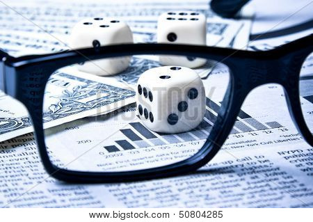 Dice On Financial Chart Near Dollars
