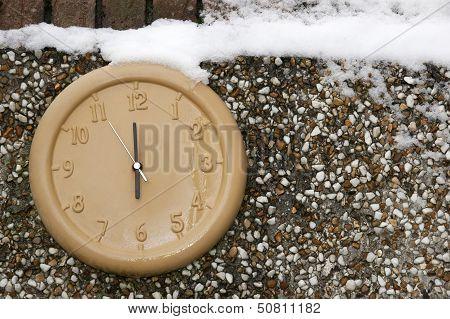 Clock On A Wall In The Winter Season