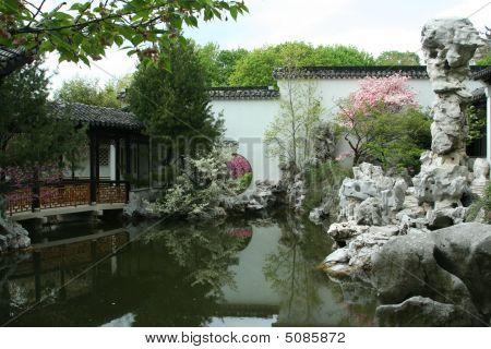 Chinese Scholars Garden Pool And Bridge.