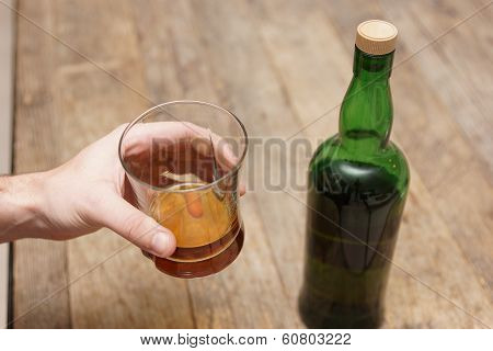 Glass of Scotch and Bottle