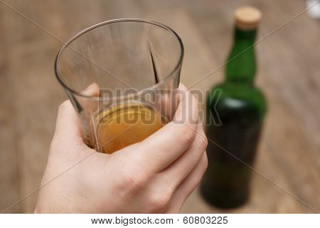 Glass and Bottle of Scotch