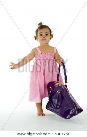 Little Thai-english Girl Walking With Purse