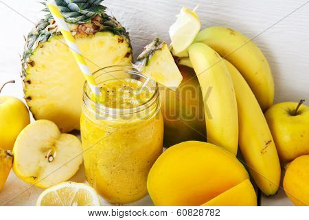 Fresh Organic Yellow Smoothie With Banana, Apple, Mango, Pear, Pineapple And Lemon