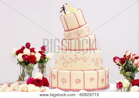 Delicious Wedding Cake In White , Creme And Pink