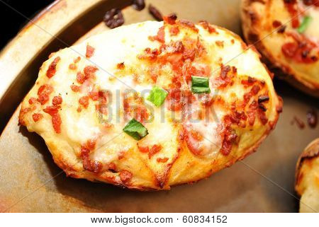 Twice Baked Potato With Cheesy Bacon On A Baking Pan