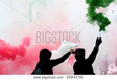 Ultras Fans With Smoke Red White And Green Dressed In Black