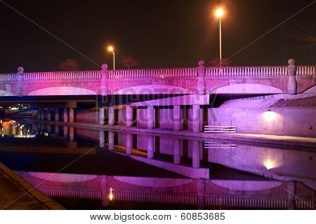 A Purple Bridge In Kansas City, Missouri In Full Reflection