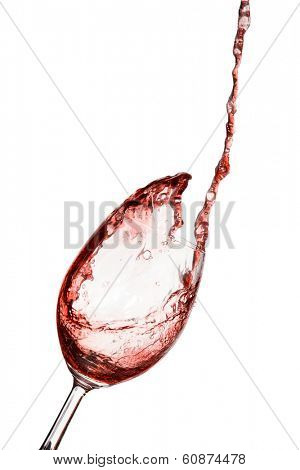 red wine being poured into a glass on a white background. water