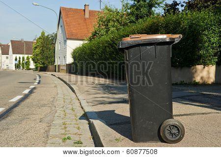 recycling garbage bin standing on urban street
