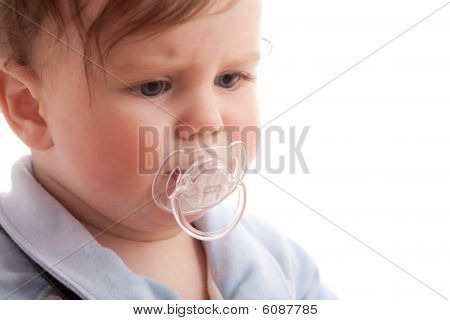 Portrait Of Displeased Baby Boy With Pacifier