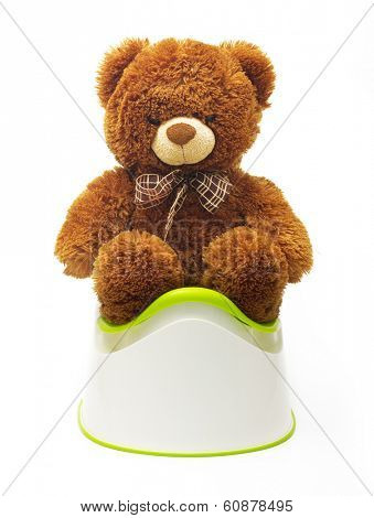 SAINT-PETERSBURG, RUSSIA - March 01, 2014: Photo of a toy bear sitting on chamber pot. Help your child learn to use a potty.
