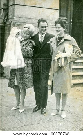LODZ, POLAND,CIRCA SEVENTIES- vintage photo of mother and godparents with a baby (christening)