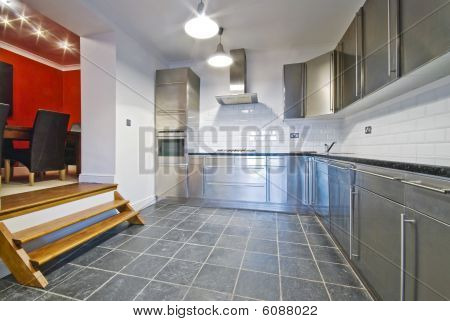 White Kitchen With Stainless Steel Cupboards