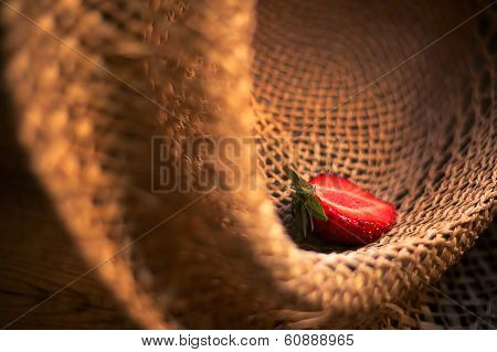 berry red strawberries in a straw hat background poster