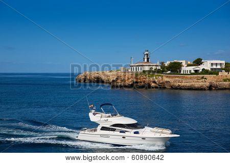 Ciutadella Sa Farola Lighthouse with yatch boat in Balearic islands