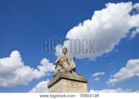 One of the statues on Pont du Carrousel over a picturesque sky in Paris France. poster
