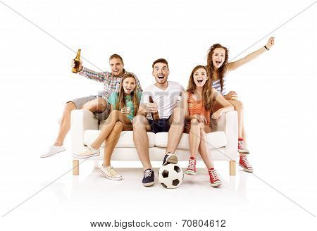 Group of young football fans on sofa