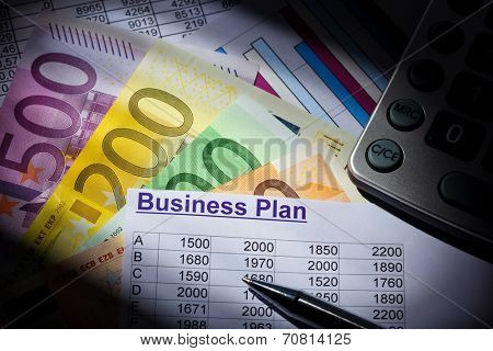 a business plan for starting a business. ideas and strategies for business creation. euro banknotes and calculator