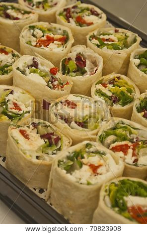 Tray Of Sliced Pitta Rolls With Cheese