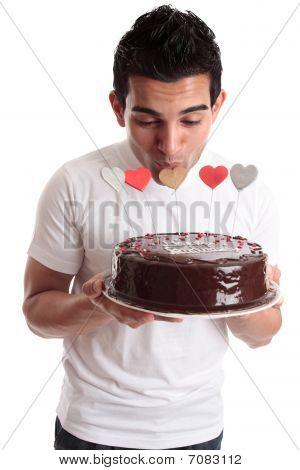 Romantic Man Kissing Heart On A Cake