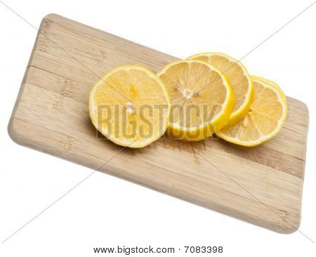 Fresh Cut Lemons On Cutting Board
