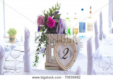 Floral Arrangement In Flashlight For Decoration Wedding Table For Guests. Room Table In A Frame