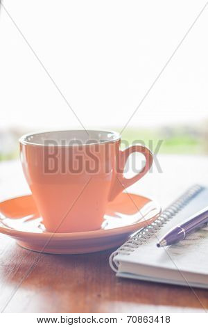 Cup Of Coffee With Pen And Notebook