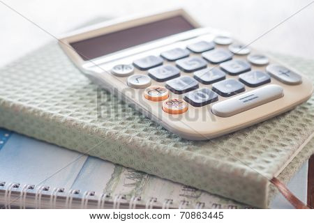 Calculator On Two Of Notebooks