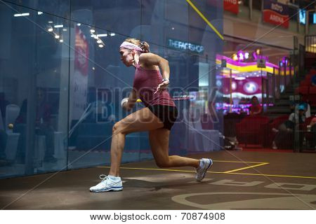 AUGUST 21, 2014 - KUALA LUMPUR, MALAYSIA: Madeline Perry of Ireland (pink shirt) reacts to return a shot in the CIMB Malaysian Open Squash Championship 2014 match held in Nu Sentral Mall.