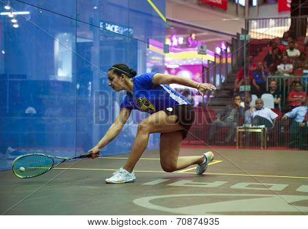 AUGUST 21, 2014 - KUALA LUMPUR, MALAYSIA: Raneem El Weweily of Egypt stretches to return in a match at the CIMB Malaysian Open Squash Championship 2014 held in Nu Sentral Mall.