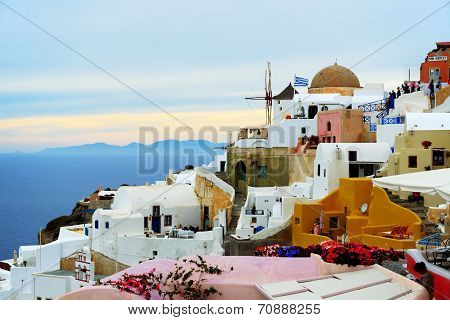 Oia, Greece - May 17: The Sunset In Oia Town And Tourists Enjoying Their Vacation On May 17, 2014 In