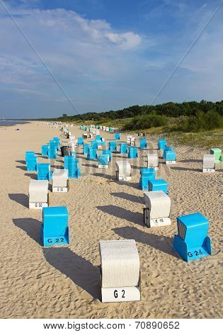 Beach in Ahlbeck with typical Baltic sea beach chairs Strandkorbs, Germany poster