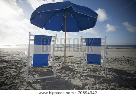 Beach Chairs and Umbrella at the Ocean