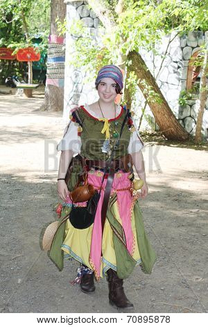 MUSKOGEE, OK - MAY 24: Women dressed in historical costume enjoys her day at the Oklahoma 19th annual Renaissance Festival on May 24, 2014 at the Castle of Muskogee in Muskogee, OK.