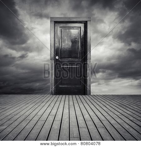 Abstract Interior Concept With Black Door And Dramatic Sky