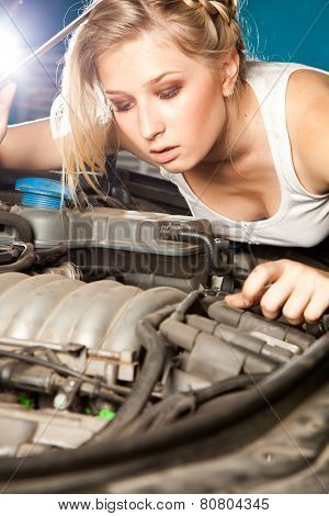 Girl Tries To Repair Broken Car