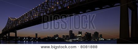New Orleans Skyline And Mississippi River Bridge