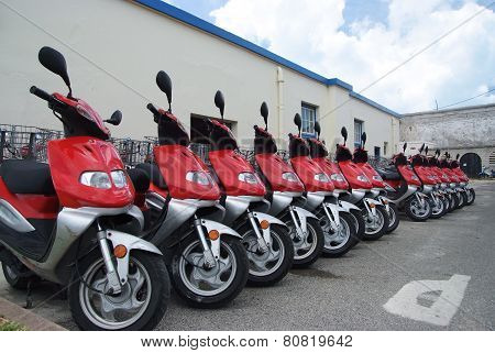Row Of Scooters On The Street