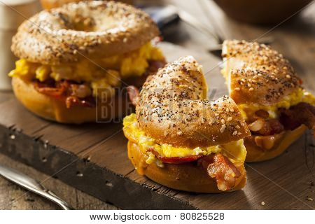 Hearty Breakfast Sandwich on a Bagel with Egg Bacon and Cheese poster