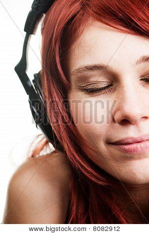 Woman Listening Music At Headphones