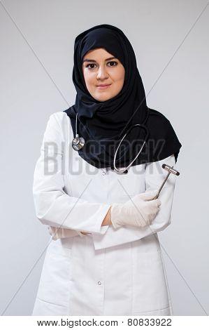 Muslim Doctor With Reflex Hammer