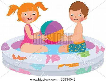Children Playing In Inflatable Pool