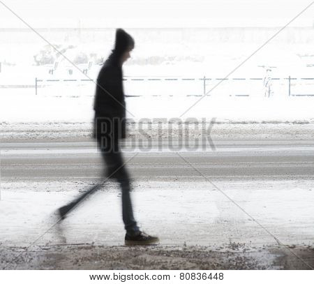 Young Man Walking In Winter