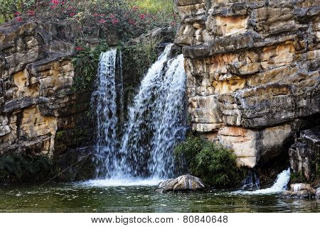 Waterfall and blue stream in the forest poster