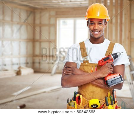 Construction worker in  new house. Renovation background.